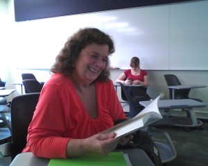 Sharon Frederick enjoying her book in class