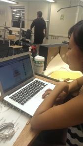 Bala checking her Facebook at Alumni Quad Gym